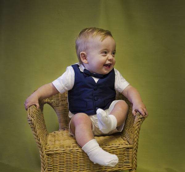 Cute, young page boy in bow tie and waistcoat