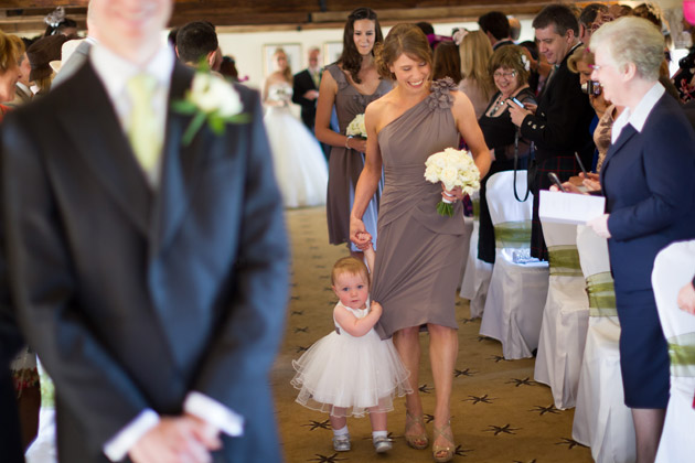 Bridesmaid and Flowergirl Walking Down the Aisle