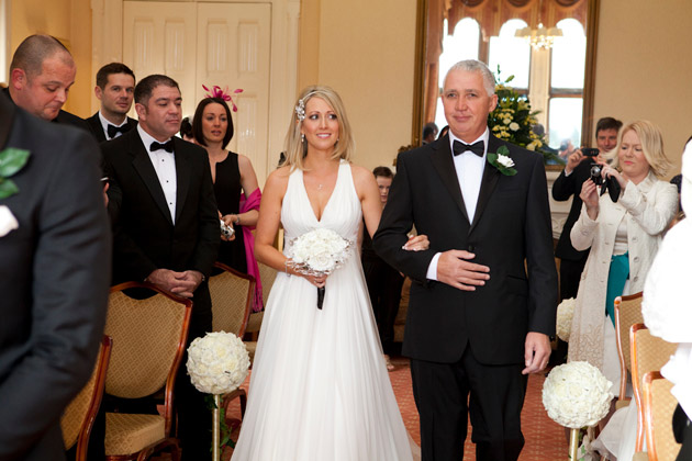 Bride And Father Of The Bride Walking Down The Aisle