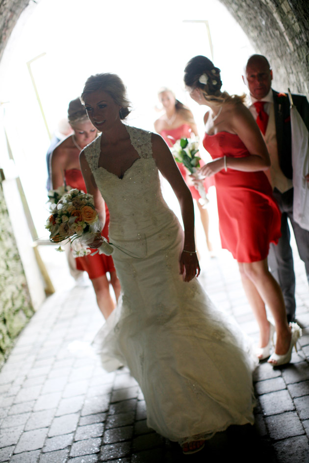 Bride and Bridesmaids Walk Through Tunnel to Ceremony