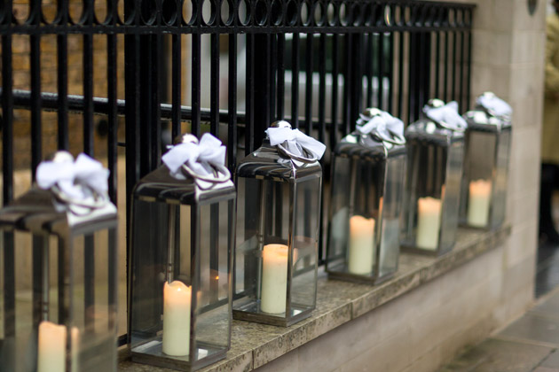 Candle Lanterns Outside Church at Ruth and Toby's Real Wedding | Confetti.co.uk