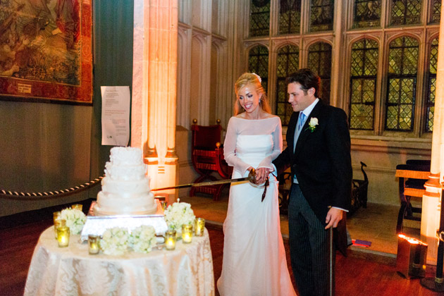 Bride and Groom Cutting Cake with Sword