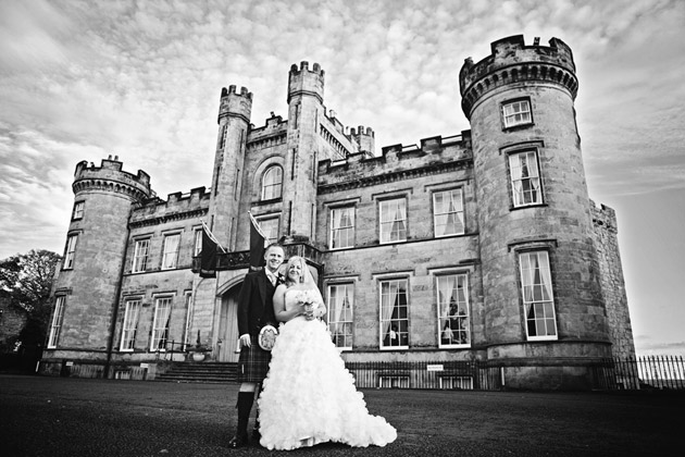 Bride and Groom Outside Castle