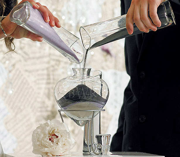 Bride and groom pouring sand