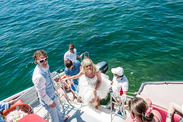 Bride & groom boarding a boat