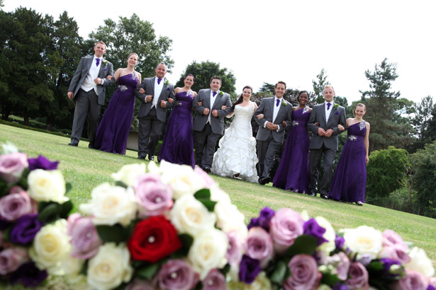 Bride and Groom with wedding guests, lavender and white bouquet