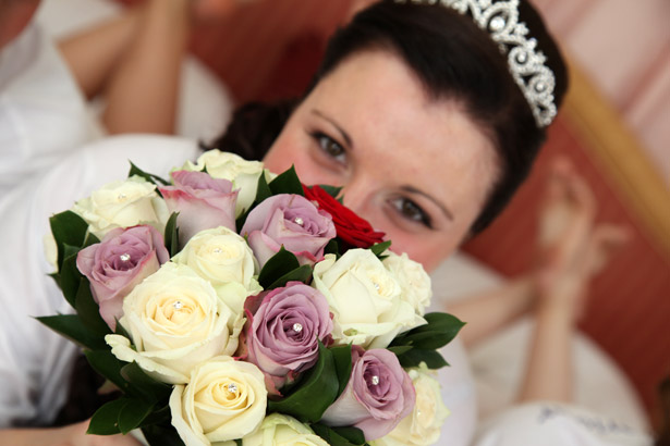 Bride with white and lavender bridal bouquet