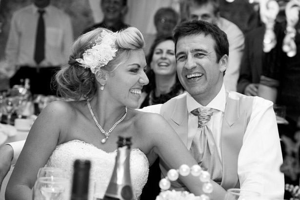 Newlyweds Laughing at the Reception