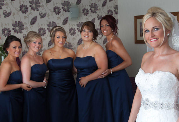Bride-and-her-bridesmaids-in-their-blue-dresses