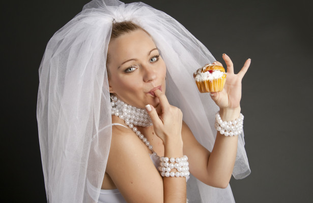 Bride eating a wedding cake
