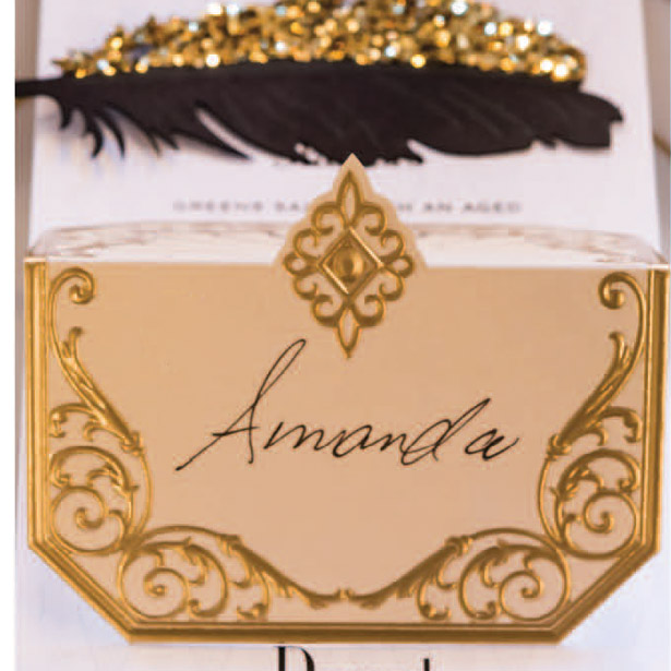 Black and gold laser decorated wedding invitation