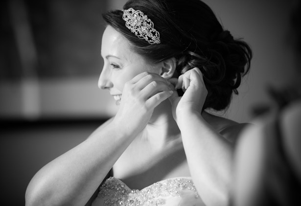 Bride putting her jewellery on