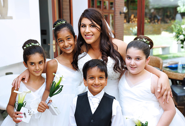 Bride with flower girls and usher