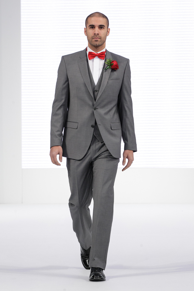 Modern grey designer suit  for the groom with red bow tie