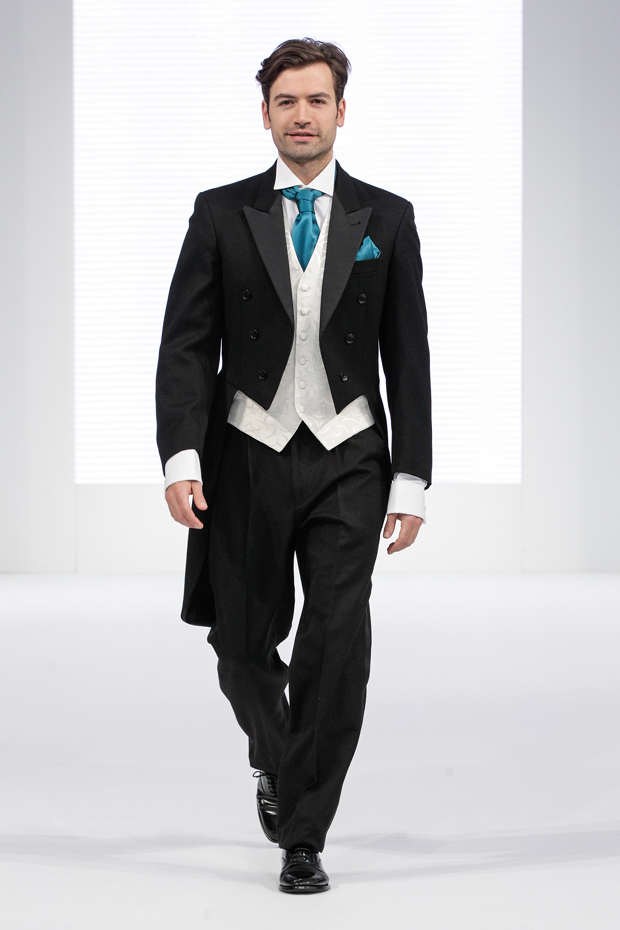 Classic designer menswear tails for the groom with turquoise cravat