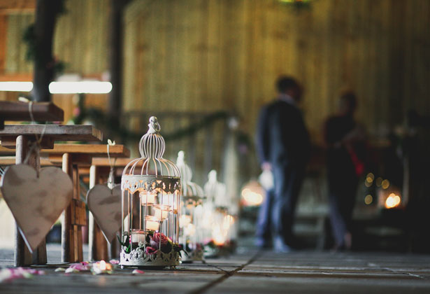 Bird cage, candles and rose petal aisle decoration