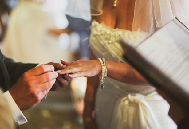 Couple exchanging rings