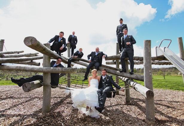 The bride and groom with the groomsmen by Sansom Photography