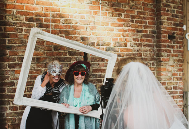 Bride taking a picture of her guests