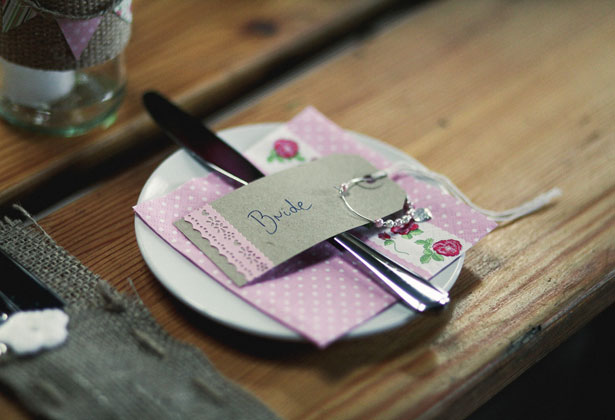 Rustic place card and pink floral napkins