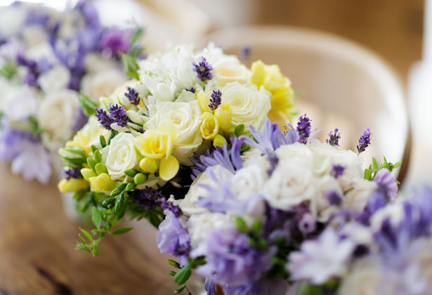 Purple, yellow and white wedding bouquets