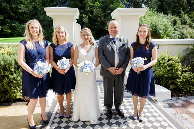 The bride with her father and her bridesmaids