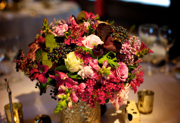 Champagne and rich purple wedding flowers