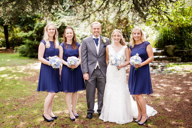 The bride and groom with their bridesmaids by Douglas Fry Photography