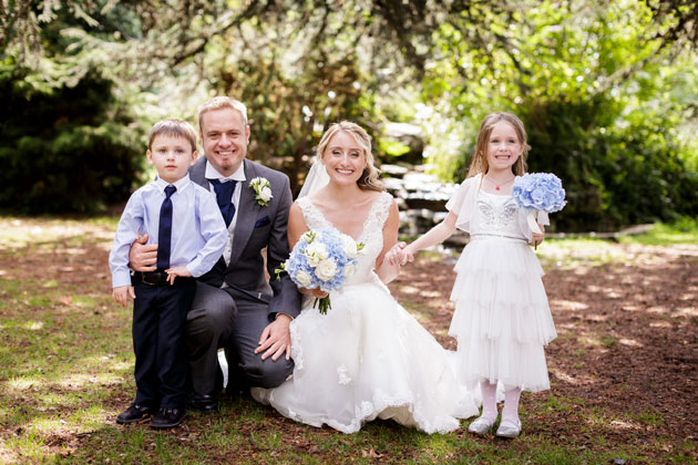 The bride and groom with their flower girl by Douglas Fry Photography