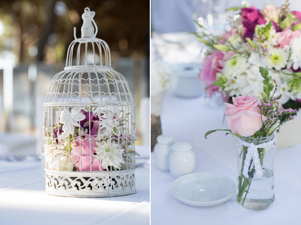 Bird cage and small vase table decoration