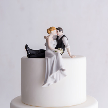 """The Look of Love"" Bride and Groom Sitting on the Edge of the Cake Couple Figurine - Romantic Wedding Cake Toppers 