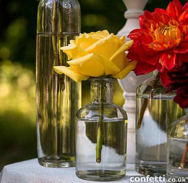 Glass vases for your wedding reception tables by Confetti