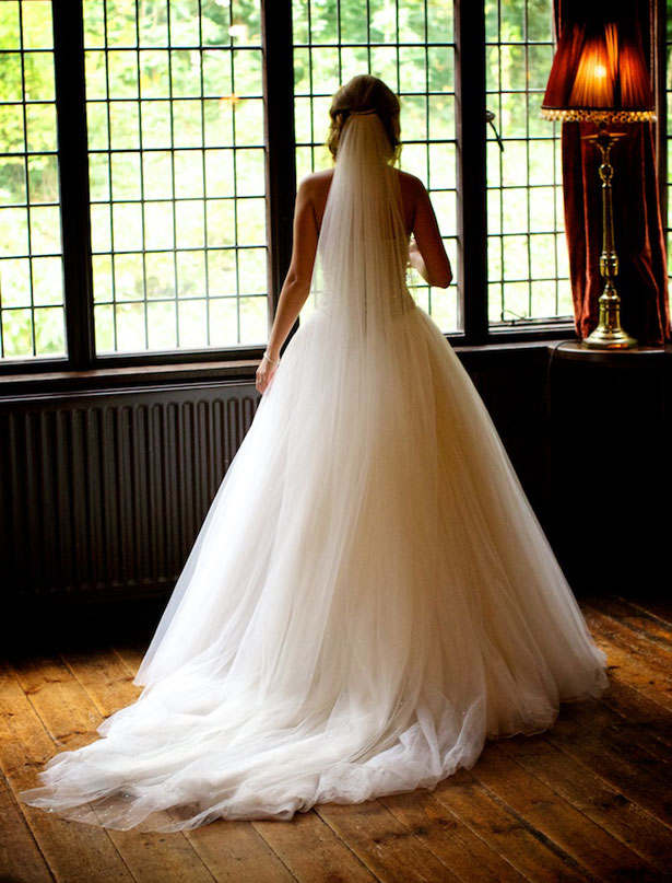Justin Alexander dress with long train