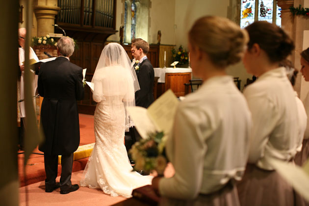 The bride and groom at the alter