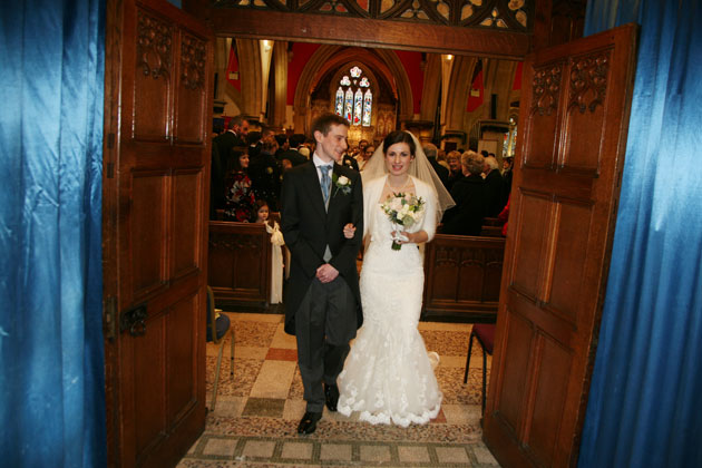 The happy couple leaving the church