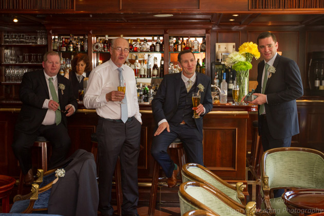 The groom with his best man and groomsman in the pub