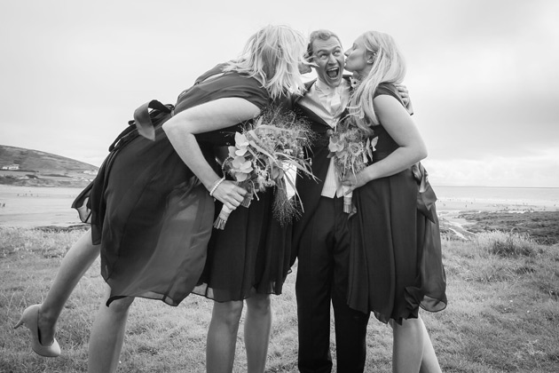 The groom with the bridesmaids