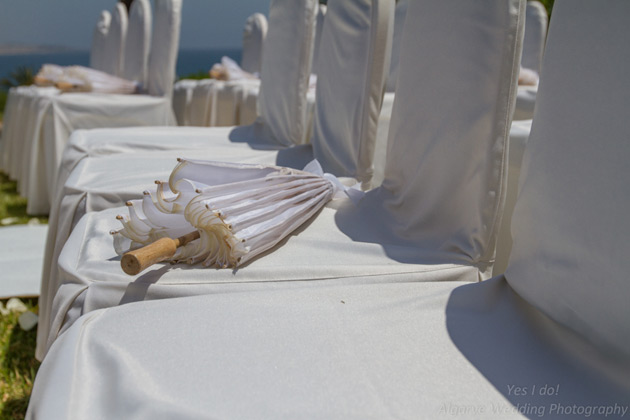 White parasol for the wedding guests