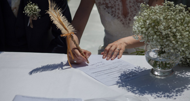 Signing the register with a feather pen