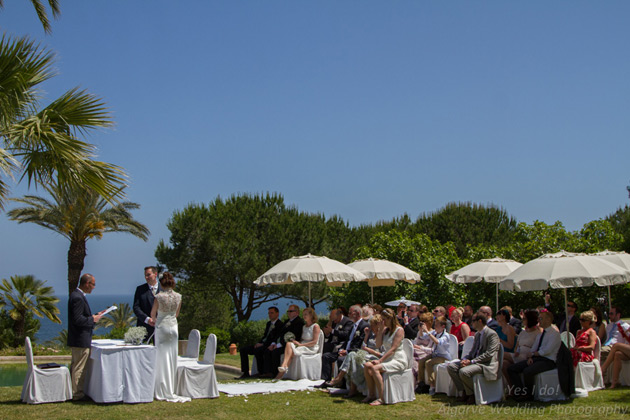 Guests watching the wedding ceremony