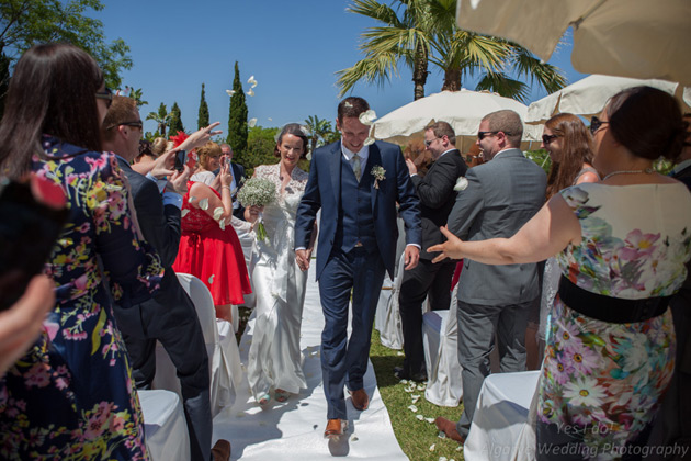 Guests throwing confetti over the newlyweds