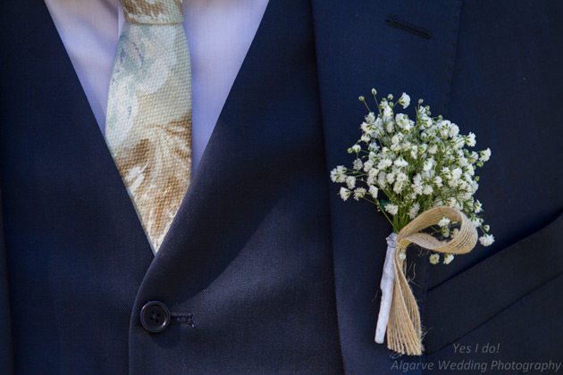 Baby breaths button hole for the groom