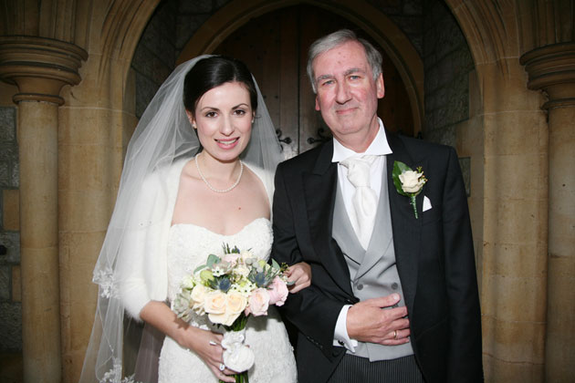 Bride with her father at entrance to the church