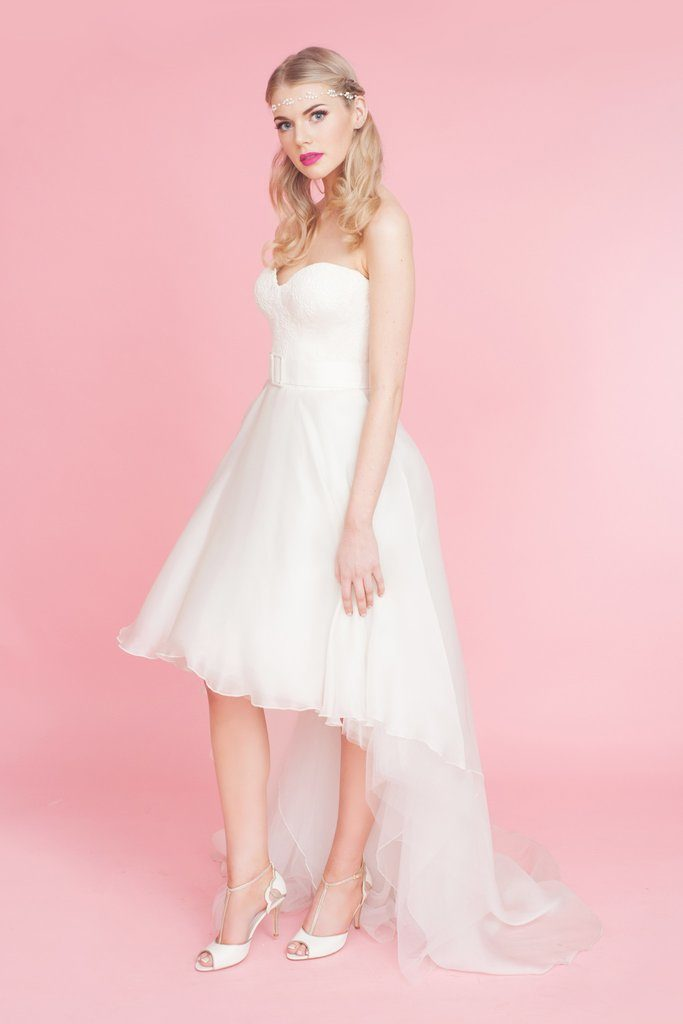 model posing in her wedding gown with Charlotte Mills ivory peep toes t-bar shoes with midi heel