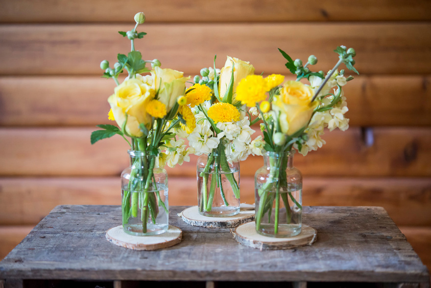 Glass Bottles and Flowers Rustic Decor   Confetti.co.uk