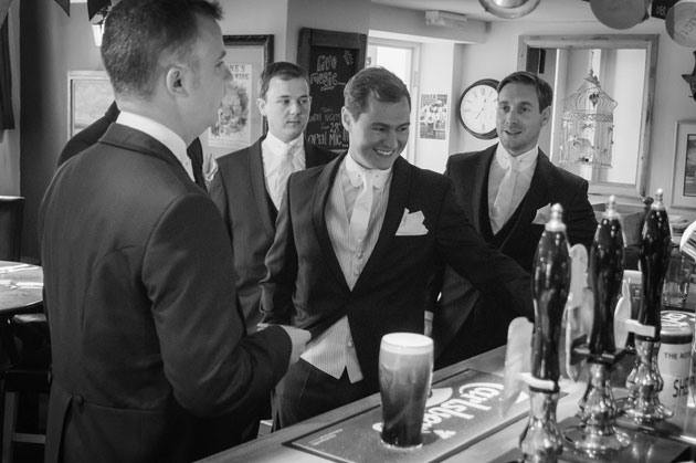 The groom with his groomsmen in the pub