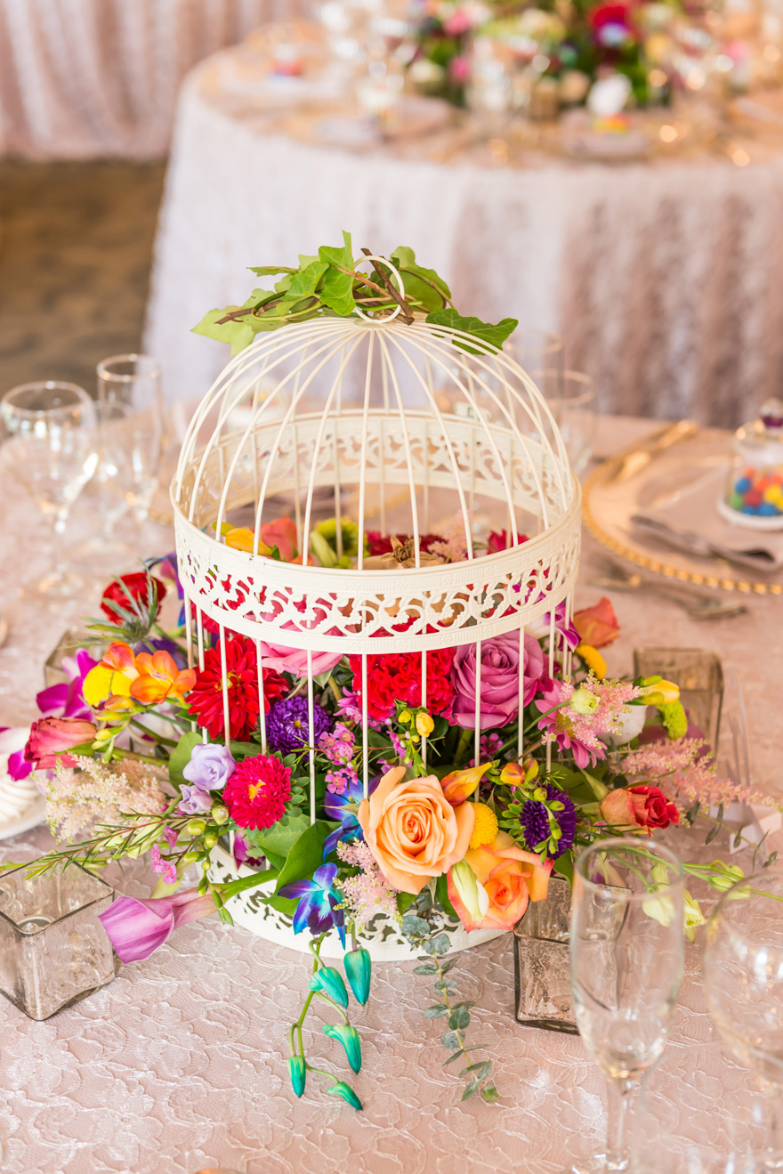 Summer Wedding Centrepiece Ideas Colourful Flowers in a Birdcage | Confetti.co.uk