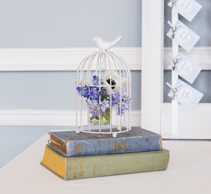 Vintage Blue Books and Floral Birdcage Wedding Theme | Confetti.co.uk