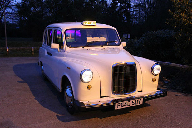 Camera Cabtastic photo booth in a London taxi cab