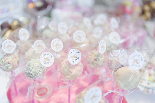 Pink and white wedding cake pops with personalised stickers